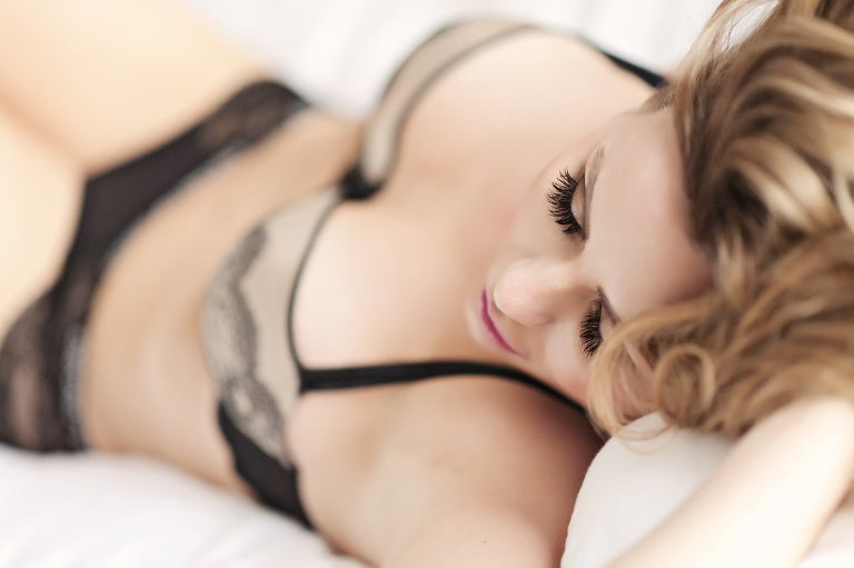 beautiful model relaxes on a bed